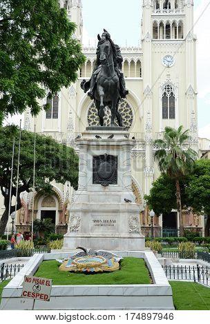 GUAYAQUIL ECUADOR - FEBRUARY 15 2017: Simone Bolivar Statue in Seminario Park. Seminario Park is also known as the Iguana Park since dozens of iguanas live in its ornate gardens.
