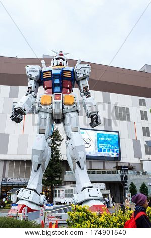Tokyo Japan - April 8 2016: Giant replica Gundam Performances at DiverCity Tokyo Plaza Odaiba Tokyo Japan. It is 18m tall The sculpture of famous anime franchise robot Gundam (Mobile Suit Gundam).