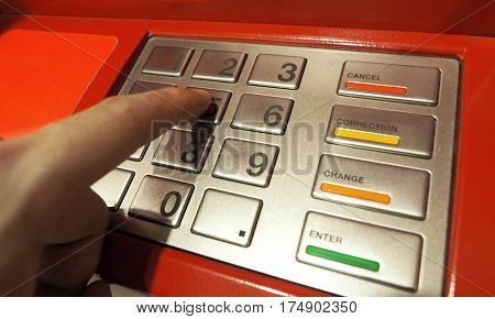 Atm Pin Button Close-up And Human Hand Index Finger.
