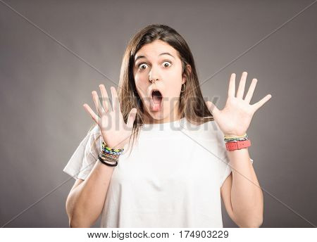 portrait of young woman with surprise expression