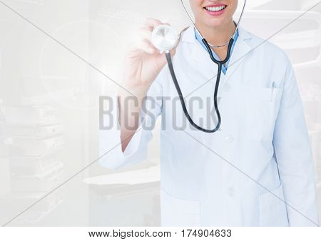 Doctor examining with stethoscope in operating room at clinic