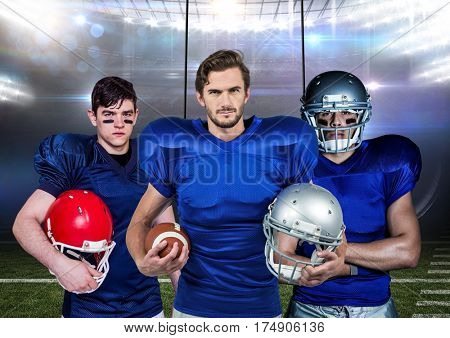 Composite image of american football players holding helmets and ball against stadium in background