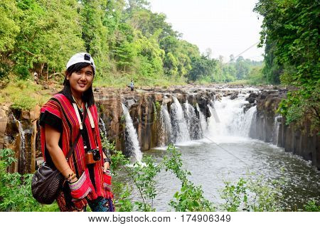 Thai Women Travel And Posing For Portrait At Tad Pha Suam Waterfall