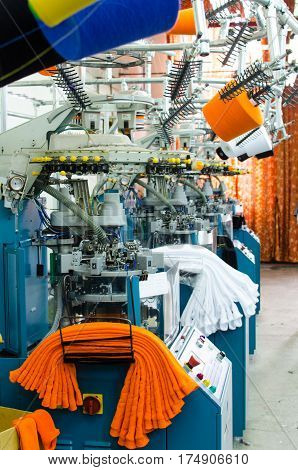 Industrial textile factory interior. Machinery and equipment in a spinning production company
