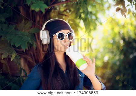 Cool Girl in Jeans Outfit Wearing Sun glasses Drinking Juice and Listening to Music