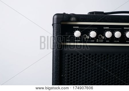 Electric bass Guitar black leather Amplifier on White Background.