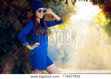 Street Style Fashion Girl Wearing a Blue Denim Romper