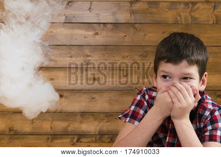 boy afraid of cigarette smoke suitable to it