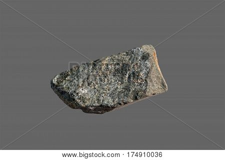 Stone with gold highlights. Isolated on a gray background.