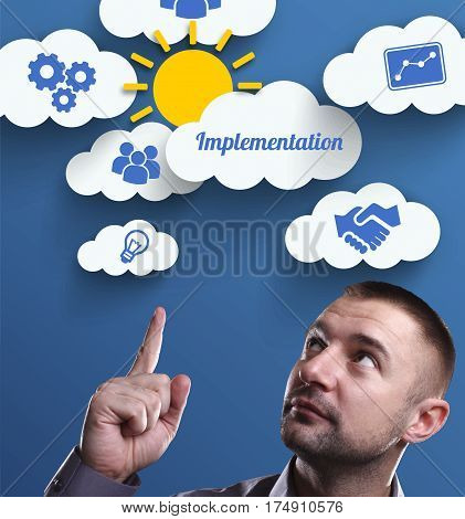 Business, Technology, Internet And Marketing. Young Businessman Thinking About: Implementation