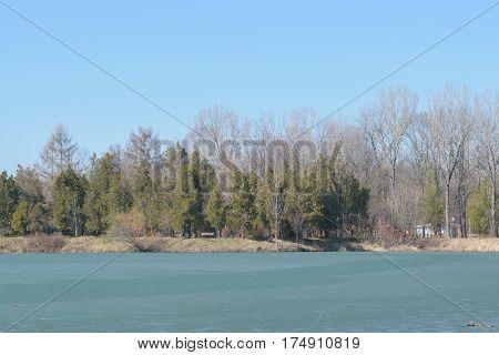 Frozen lake in spring time at Memorial Park Constantin Stere in Bucov near Ploiesti Romania