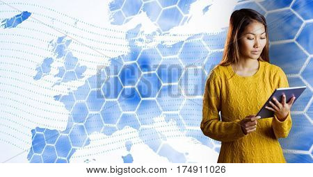 Digital composition of woman using digital tablet against digitally generated background