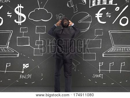 Digitally generated image of thoughtful business professional looking at the blackboard