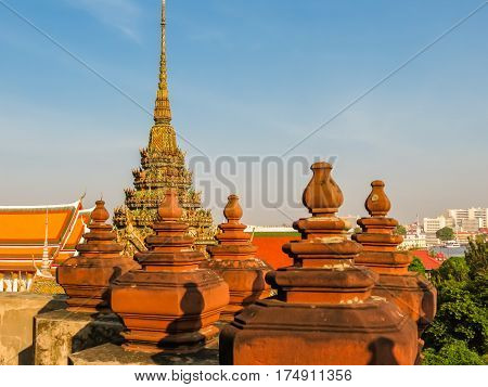Ancient buddist Wat Arun Temple or Temple of Dawn. Bangkok, Thailand. Selective focus
