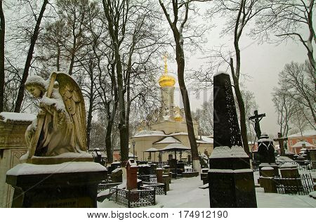 angel on the background of the Orthodox Church in the snow in the Moscow monastery