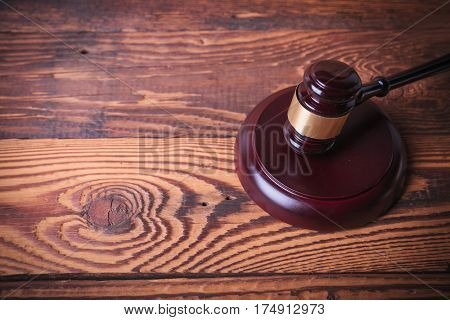 judge's gavel on old fir wood background, studio picture