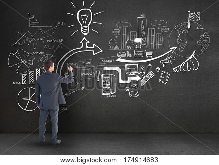 Digitally generated image of focused business professional writing on the blackboard
