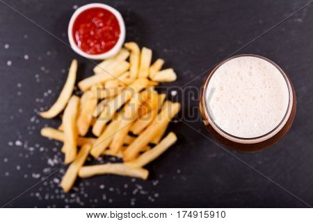 Glass Of Beer With French Fries