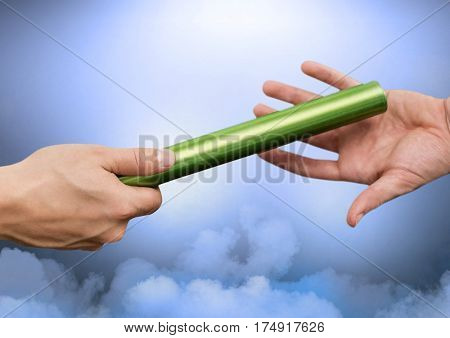 Hand of athlete passing the baton to teammate