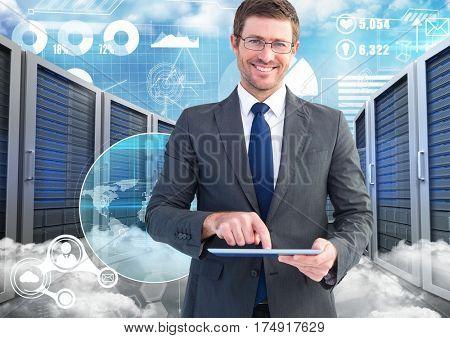 Digital composition of businessman using digital tablet against data center in background