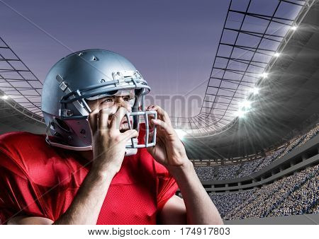 Digital composition of american football player removing his helmet against stadium in background