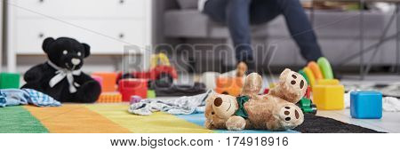 Soft toys laying on the floor in living room interior