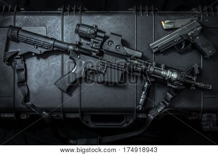 assault rifle ar15 with pistol on case