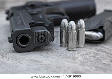 pistol or handgun with bullet and magazine