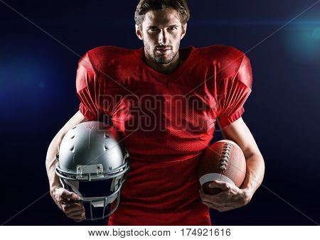 Portrait of confident athlete holding american ball and headwear against digitally composite background