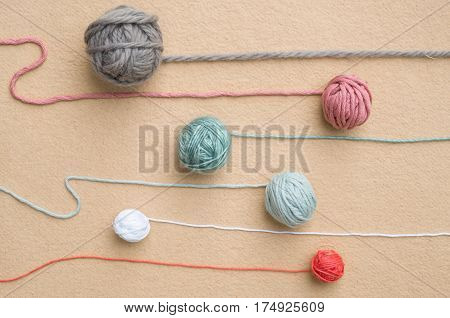 Balls Of Wool Of Various Colors With Trailing Strands