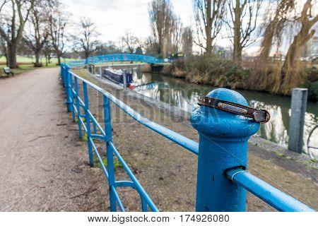 Doggie collar on railing along Nene river in Northampton UK.