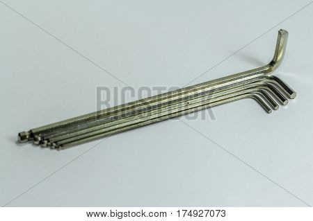 Hex key Set on white background.A hex key, Allen key or Allen wrench is a tool used to drive bolts and screws with hexagonal sockets in their heads.