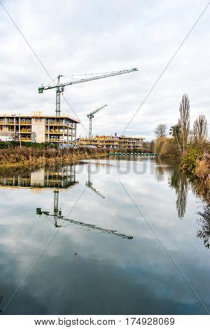Construction crane at building site on Nene river, Northampton.
