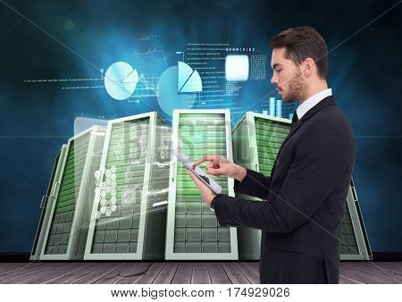 Digital composite of businessman using digital tablet against server room and graph chart background