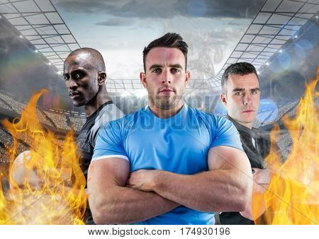 Digitally composite of american players standing with arms crossed between the fire flame in stadium