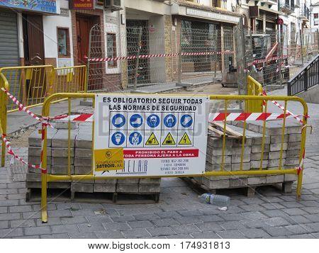 Alora Spain - March 5 2017: Compulsory warning sign at roadworks in Village street