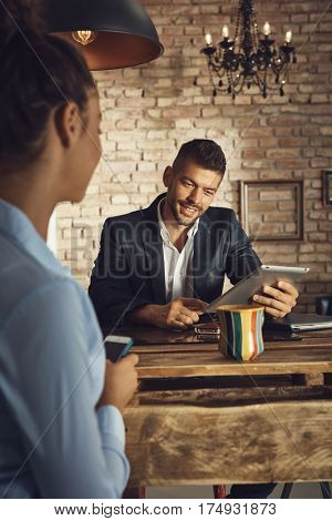 Young couple using tablet at home.