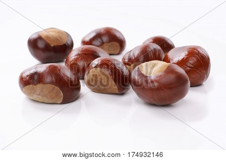 group of chestnuts or conkers on white background
