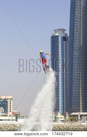 Extreme sportsman on flayborde climbs to perform tricks in the competitions in extreme sports in Dubai