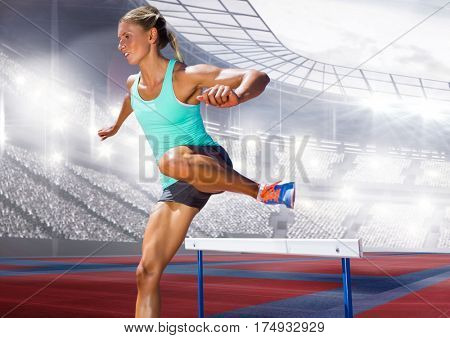 Digital composite image of female athlete jumping above the hurdle in stadium