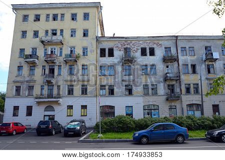 Kronstadt Russia - July 14 2016: Demolition multi-storey building on the street with parked cars