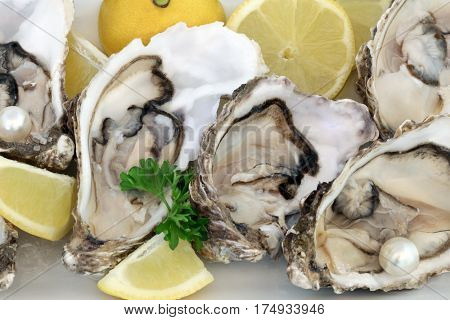 Fresh oysters with lemon, parsley and pearls.