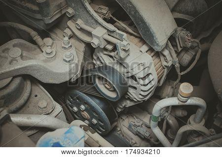 Dirty details of car engine. Macro shot.