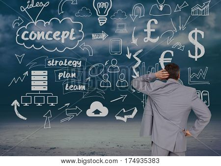 Confused businessman looking at start up icons against digitally generated background