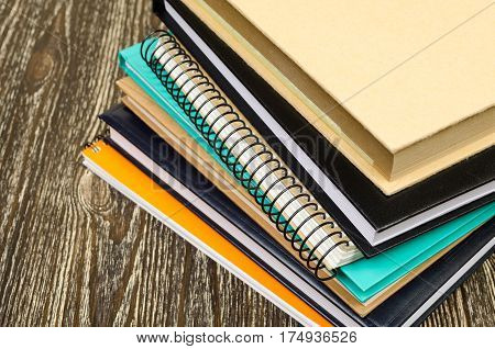 Folded Stack Of Workbooks.