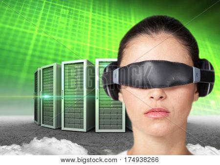 Digital composite image of woman using virtual reality headset against server tower