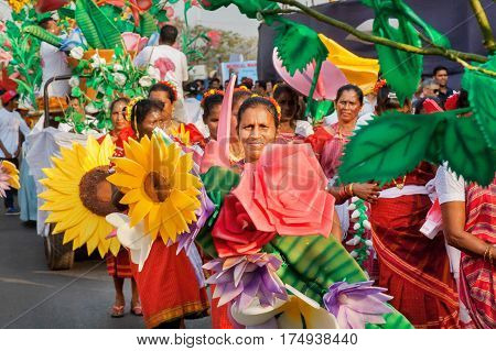 PANAJI, INDIA - FEB 25, 2017: Senior women with colorful artificial flowers walking to a parade at traditional carnival in Goa on February 25, 2017. Carnaval is celebrated in Goa since 18th century