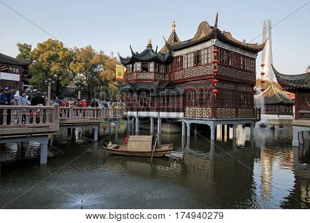 Shanghai, China - March 2, 2017: Tourists Walking At Sunset In The City Temple Of Shanghai, In The O