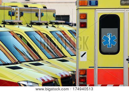 detail of emergency ambulance cars in hospital yard