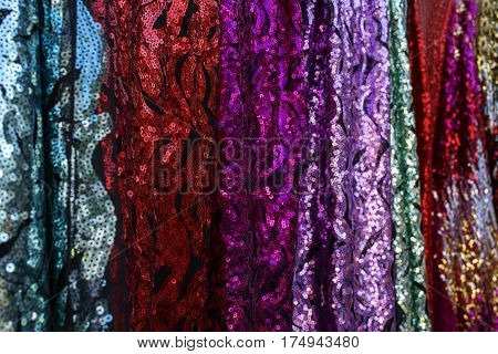 Multicolour textile with pailettes in a row